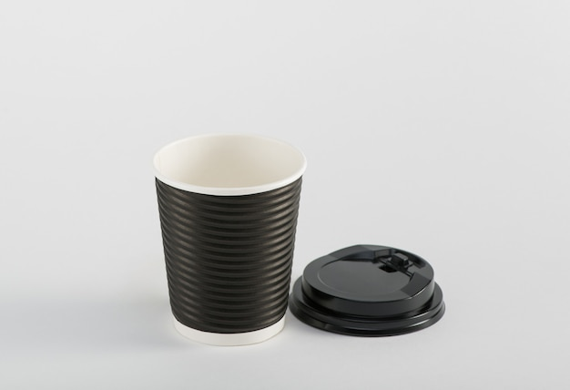 Empty black paper cup coffee  in takeaway  isolated on white background