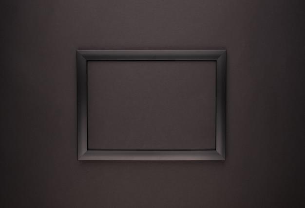 Empty black photo frame on black