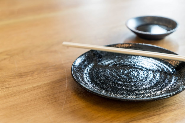 Empty black plate on table