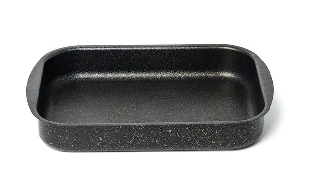 白い背景、上面図で分離された空の黒い長方形の焦げ付き防止オーブントレイ