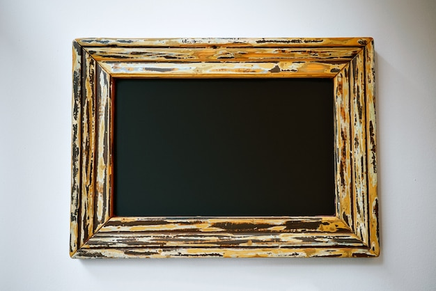 Empty black sign in a pretty frame
