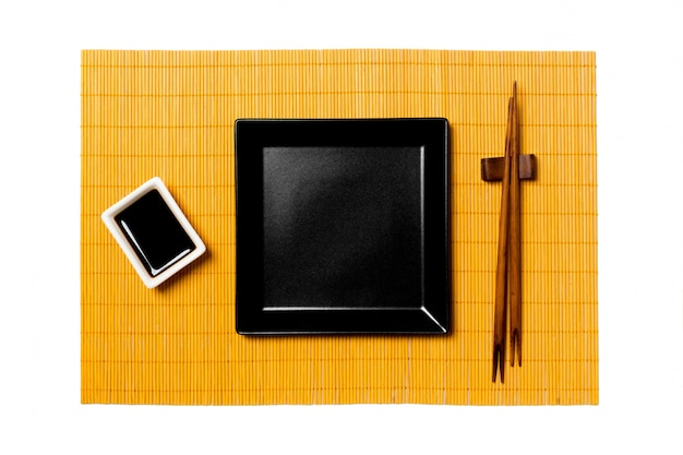 Empty black square plate with chopstick