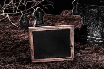 Emptyblackboard on Halloween graveyard