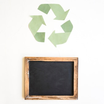 Empty blackboard and recycle sign