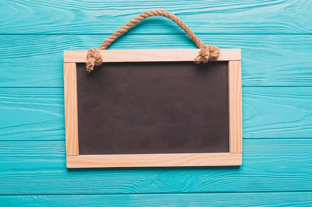 Empty blackboard on turquoise background