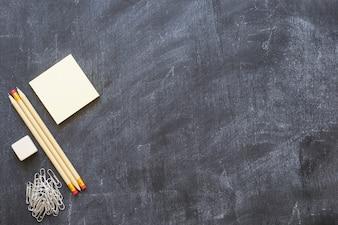 Empty blackboard with stationery