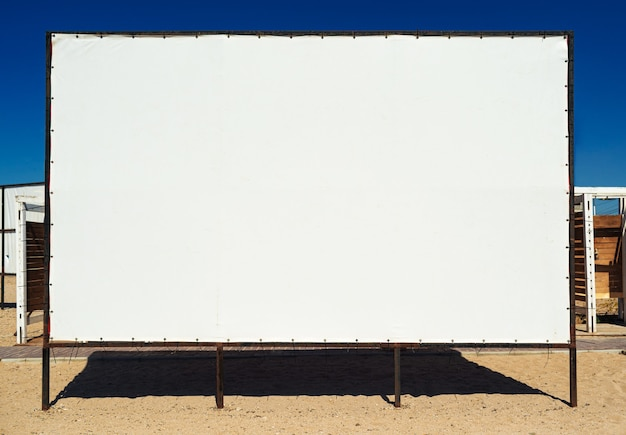 Empty blank billboard on the beach close up