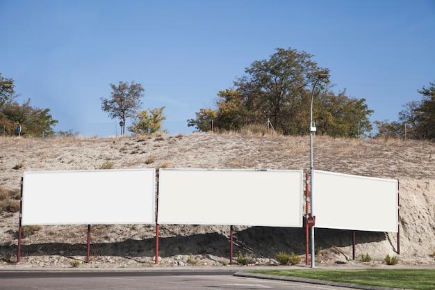 Empty blank billboards near the road