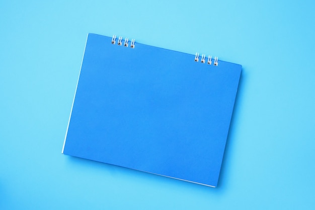 Empty blank calendar on blue background
