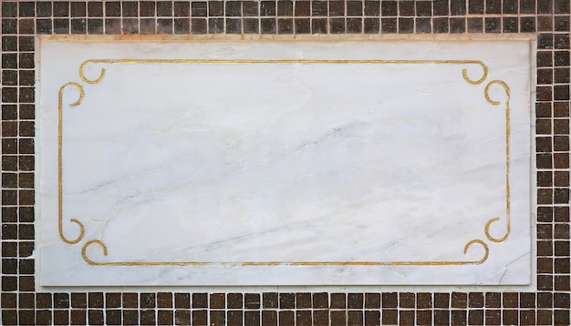 Empty blank marble label on tile wall.