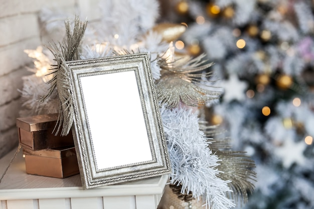 Empty blank photo frame in christmas decorations