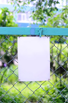 Empty blank sign at a fence