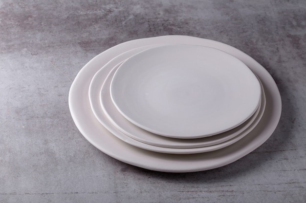 Empty blank white ceramic dish on cement board
