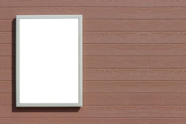 Empty blank white mock up board on brown wood panels wall background.