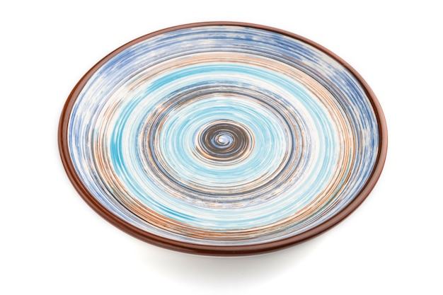Empty blue ceramic plate isolated on white