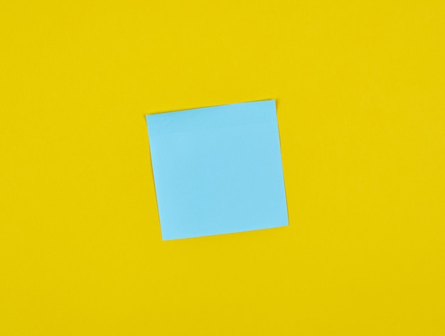 Empty blue paper square stickers on yellow