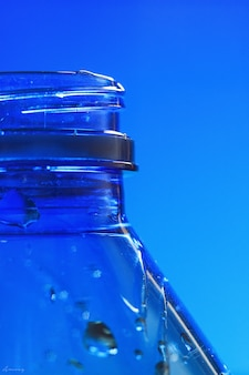 Empty blue plastic bottle