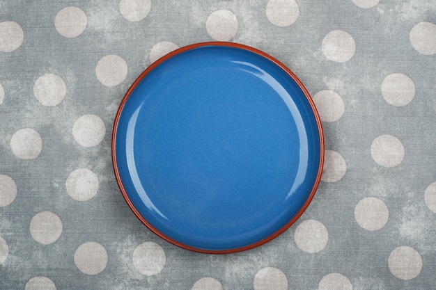 Empty blue plate and napkin