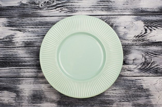 Empty blue plates over wooden table