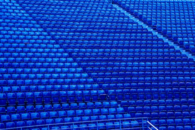 Empty blue seats in stand of the soccer stadium.