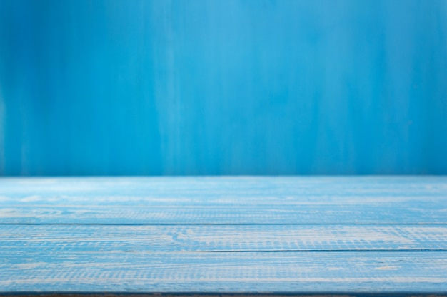 Empty blue wooden table in front, plank board background texture surface
