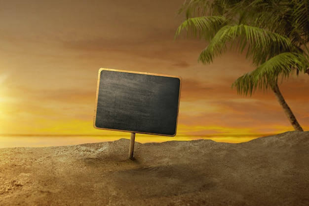 Empty board for copyspace area on the sandy beach at sunset