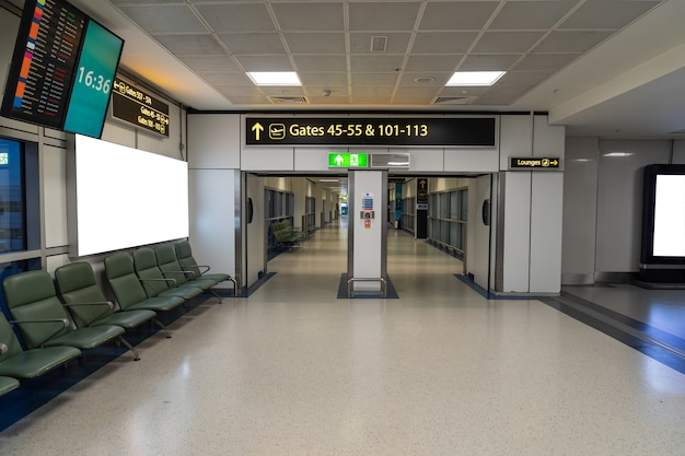 Empty boarding gates with chairs with no people in the airport