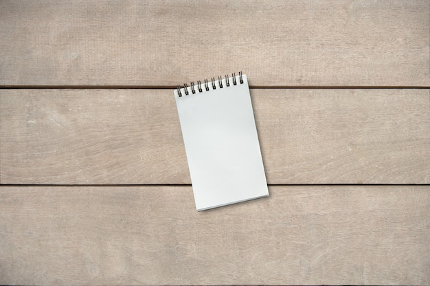 Empty book on wooden table of brown