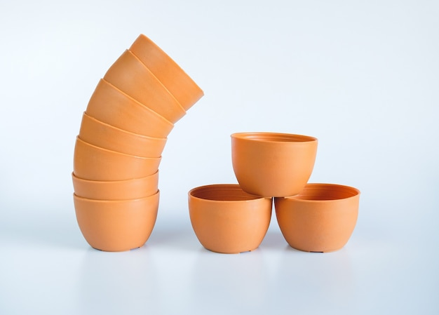 Empty brown flower pots isolated on white background.