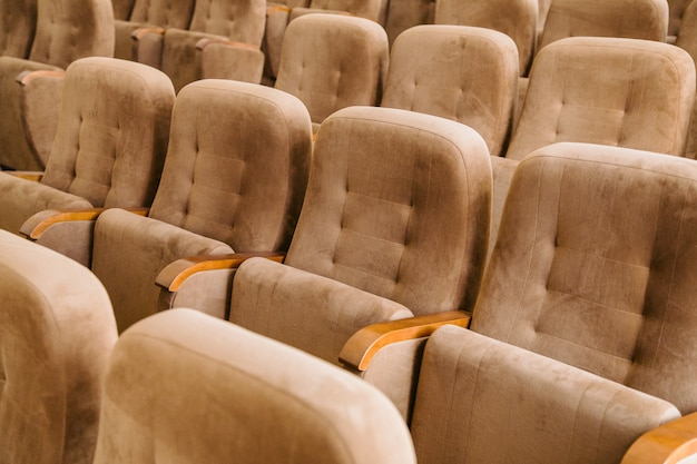 Empty brown velvet cinema seats