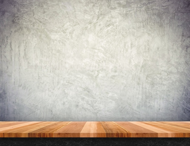 Empty brown wood table top with concrete wall,mock up for display or montage of product