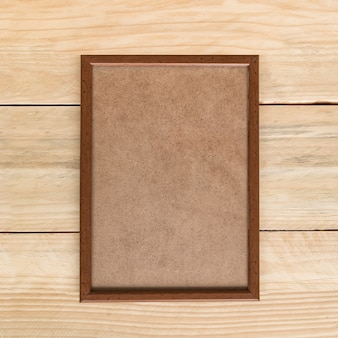 Empty brown wooden photo frame