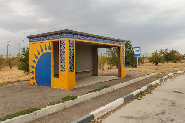 Empty bus stop on the road in kazakhstan, waiting place for the bus