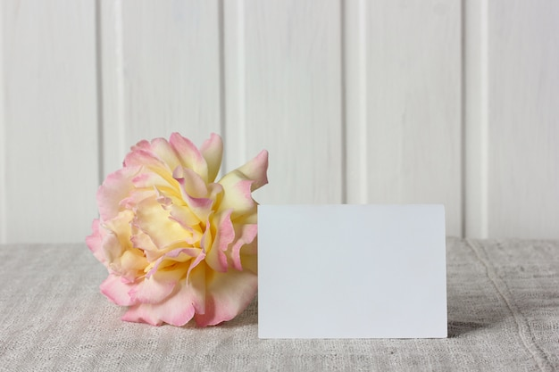 Empty business card and a rose. mockup, scene creator.