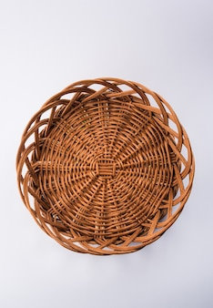 Empty cane basket or tokri in hindi and topli in marathi, isolated over white background