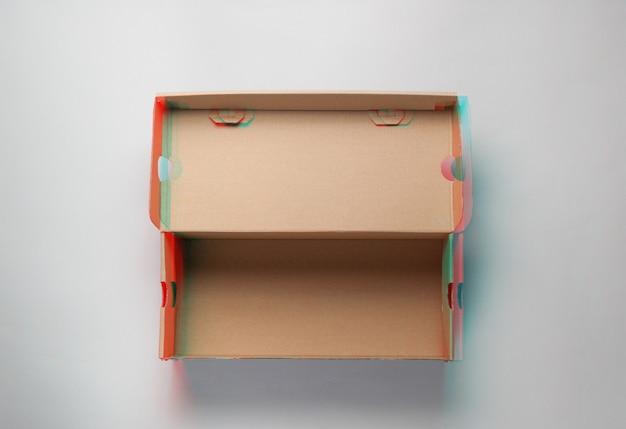 Empty cardboard box on gray.