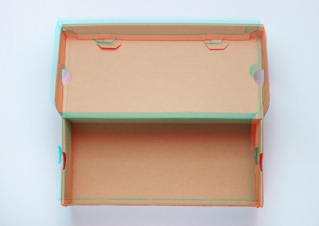 Empty cardboard box on white. glitch effect