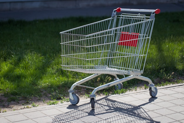 An empty cart for products near the supermarket