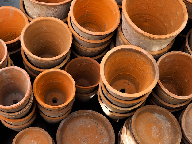 Empty ceramic brown flower pots, pile of natural tree pot made from clay