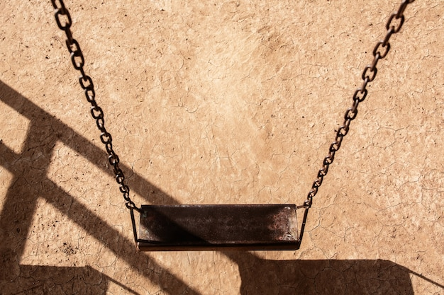 Empty chain swing in playground