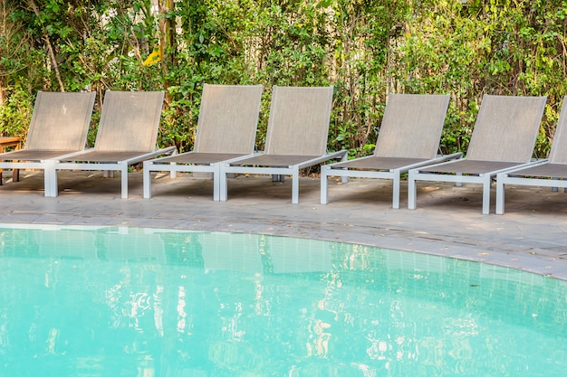 Empty chair around swimming pool in hotel resort