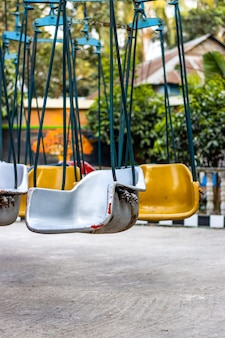 Empty chair of carousel rides