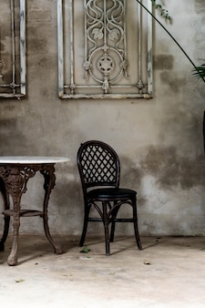 Empty chair and table in vintage room