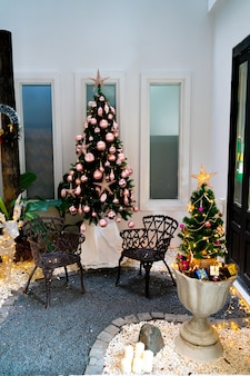 Empty chair with christmas tree and gift box for christmas and new year festival