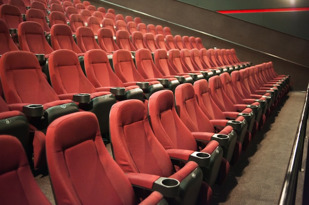 Empty chairs in cinema audience