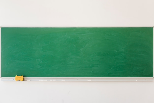 Empty chalkboard in classroom in school