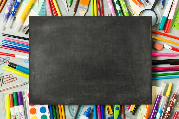 Empty chalkboard on a colourful background