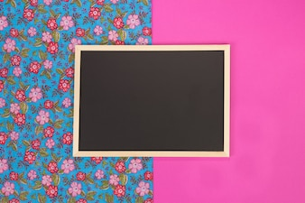 Empty chalkboard on pink background with copy space.