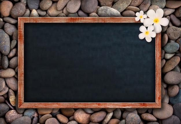 Empty chalkboard on rocks