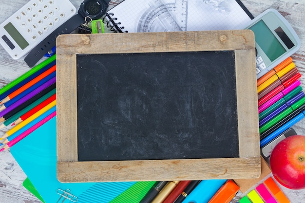 Empty chalkboard with copy space and school supplies